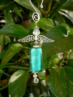 Hand blown teal glass rectangle shaped hanging angel by LindaGillottiDesigns on Etsy