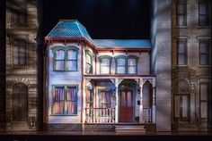 Behind the scenes of You Can't Take It With You on Broadway / The fictional Vanderhoff family's home is a colorful Victorian wedged between grayscale 1930s developments.