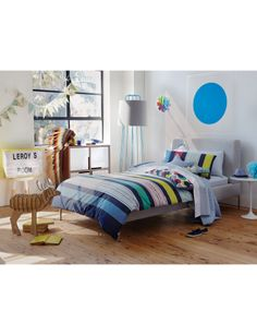Bold, bright stripes lift the spirits and add a timeless feel to this quilt cover set, while the reverse captures the excitement of  finding a favourite animal. Why count sheep when gorillas, birds and lions are so much more fun?