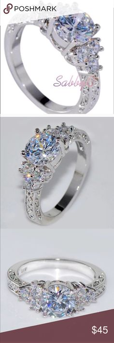 New 18 k White Gold Engagement Ring Brand new real 18 k white gold filled with lab created diamonds engagement wedding ring. Also have wedding ring sets, engagement rings , wedding bands in my listing for sale. Available in all sizes. Jewelry Rings