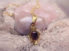 Gothic Garnet Necklace  She walks in beauty, like the night Of cloudless climes and starry skies; And all that's best of dark and bright - from She Walks in Beauty by Lord Byron  Details: • Vintage pendant from 50s; height 20mm • 8x6mm Indian Garnet • 20-inch gold-plated necklace chain • Sits 2.5 inches below collarbone • Dainty necklace, layers well   Right out of a Victorian gothic, this necklace bewitches with the blood red crimson of the Garnet stone and the ornamentalism of the…
