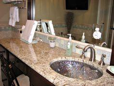 Gold granite + espresso cabinets