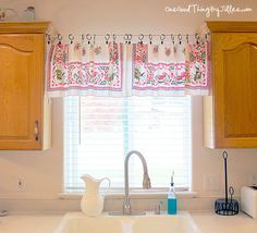 Quick and Easy Window Valance using a tension rod, thrift store tablecloth, and shower curtain clips.