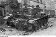 France, village of Villers-Bocage, June 1944: British Cromwell Cruiser Tank VIII disabled by German tank fire lies amid the ruins during bitter fighting shortly after the Normandy invasion.
