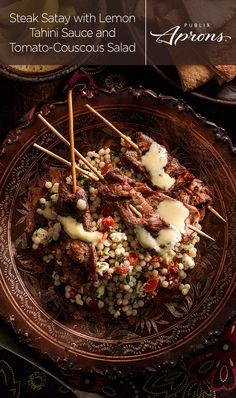 Take a dinner vacay with the Steak Satay with Lemon Tahini Sauce and Tomato-Couscous Salad. The lemon tahini sauce gives your grilled or skewered ribeyes big flavor with olive oil, lemon juice, and lemon hummus. The Tomato-Couscous Salad makes the perfect side to this Mediterranean masterpiece from Publix Aprons.