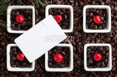 coffee cups and beans with placard. - Close-up shot of coffee cups with coffee beans with empty placard on top.