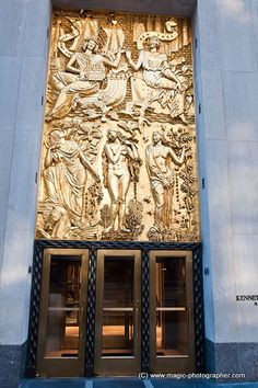 """La Maison Francaise entrance, 610 Fifth Ave, Rockefeller Center...  """"Friendship of France and United States"""".  Gilded gold relief, by Alfred Janniot."""