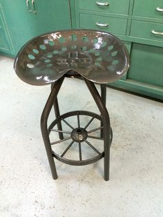 Tractor seat bar/shop stool that swivels with wagon wheel footrest