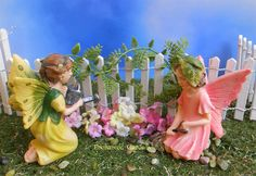 Mini fairies planting the spring fairy gardens.
