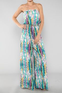 This strapless flowy wide leg tunic jumpsuit has a cinched belted waist with an artistic flair print.    100% Polyester  Color: Jade