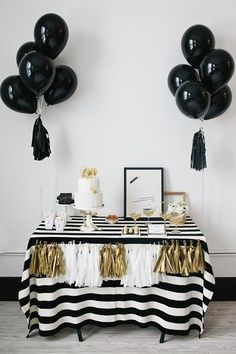 Would be cute for a grad party. Ribbons on the black balloons remind me of graduation tassels