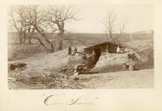 An unidentified family in front of their dugout, presumably near McCook, Nebraska, about 1890.