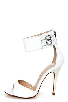 Check it out from Lulus.com! Strap in, sit back, and enjoy the ride in your Chinese Laundry Joy Ride White Ankle Cuff High Heels! Smooth white kid leather forms a sexy split upper with a peep toe below, and a cupped heel way above, where a thick ankle cuff wraps around your ankle, and fastens with twin belts and silver buckles (with hidden elastic). 4