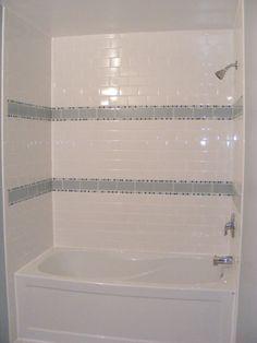 Beautiful Gloss White Tile Bathroom Wall Subway Shower Bathtub With Gray Striped Ceramic Wall Decor In Small Guest Bathroom Designs