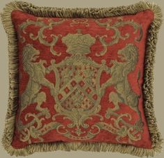 Heraldic tapestry fringed cushion.