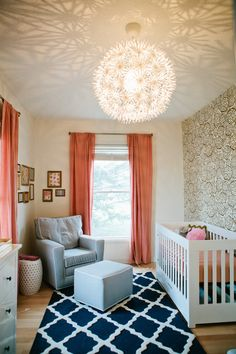Photographer Pam Cooley via Grey Likes Baby | gold + white wallpaper, pink drapes, navy rug - gorgeous baby girl nursery