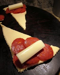 pepperoni crescent rolls    1 can refrigerated crescent rolls  40 slices turkey pepperoni  4 pieces of mozzarella string cheese, cut in half  garlic powder  pizza sauce    Preheat oven to 375.    Unroll crescent rolls and separate into 8 triangles. Place 5 slices of turkey pepperoni on each crescent roll. Top pepperoni with string cheese half and r