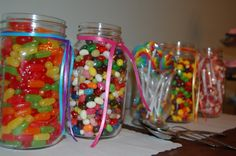 Mason Jars filled with candy – an idea for Sweet 16. Each girl could make their own treat bag.