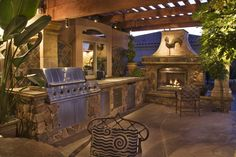 Ample counter space and a large ensure that this outdoor kitchen is ready for large parties.