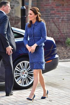 Kate Middleton wearing Royal Collection Garrards Jewellers 12k Ceylon Sapphire and Diamond Engagement Ring, Stuart Weitzman For Russell & Bromley Navy Suede Muse Clutch, Cartier Ballon Bleu Stainless Steel Watch, Rupert Sanderson Malory Pumps, Rebecca Taylor Sparkle Tweed Ruffle Jacket and Rebecca Taylor Blue Sparkle Tweed Dress