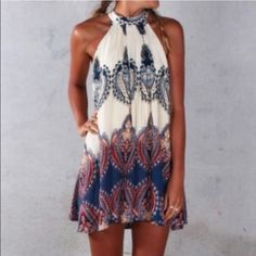 """Bohemian style dress style from the neck Beautiful halter dress. Bought online from Australia. The size fit perfect, I just do not like the way it fits me. I am 5'7"""" and it is just long enough to be a dress on me.  Size in US: 4/SMALL. Never worn, excellent condition.   Has lining. Dresses"""