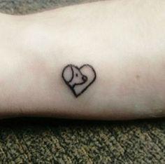 39 dog tattoos to celebrate your four-legged best friend: Minimalist dog tattoo