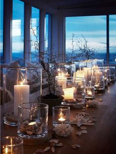 Coastal living tablescape with a view to die for. Love the candles, hurricane and shell combination: simple, but beautiful. Light it up with Mirage LED candles so you can use the remote. Coastal Homes, Coastal Living, Coastal Style, Coastal Decor, Coastal Colors, Bright Colors, Beach House Decor, Home Decor, Deco Table