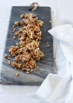 Seriously addictive grain-free granola made with nuts, seeds, and coconut! Paleo, vegan, gluten-free, dairy-free, sugar-free. Follow link for recipe!