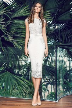 46059b30ec2d 28 Chic Spring Bridal Shower Outfits To Get Inspired  perfectly fitting  white lace midi dress with cap sleeves and a sash