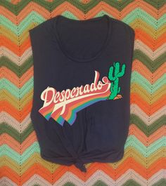 Desperado 70s Retro Muscle Tee Super fun 70s style Muscle tee in the softest 100% vintage style cotton Rainbow Retro Style text and of course a super fun cactus! Made in the USA Raw cut arm holes and