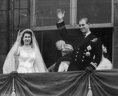 Queen Elizabeth II and Prince Philip are pictured on the balcony at Buckingham Palace waving at the crowds in November 1947 following their wedding