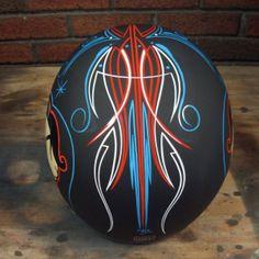 flat black motorcycle helmet with pinstripes