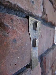 Brick Clip: hang things on brick with no tools, no drilling!!  When I asked at lowes they looked at my funny?!?  I have to find these!
