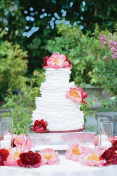 Stunning ruffled wedding cake! Love the burgundy and pink flowers too. | On Bridal Guide via Lover.ly