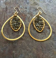 A personal favorite from my Etsy shop https://www.etsy.com/listing/245808594/gold-hoop-earrings-with-labradorite