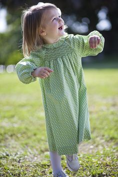 The leaves may be turning red and yellow, but she still looks stunning is green!  #orientexpressed #green #dresses #smocking