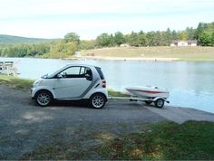 "2008 smart car with a ""smart boat"" first a tiny car, now a tiny boat?"