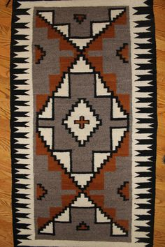 719. Description: Native American weaving: by Angelia Begay, Pine Springs Az., Ca 1950. Comes with original Certificate of Genuineness from the Historic Hubbell Trading Post. Made from handspun wool a