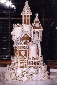 I think it passed Gingerbread House a while ago. more like a Gingerbread Castle! Gingerbread Castle, Christmas Gingerbread House, Noel Christmas, Christmas Treats, Winter Christmas, Christmas Cookies, Christmas Decorations, Gingerbread Wedding Cakes, Christmas Wedding