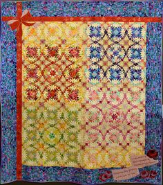 "Full size 205 cm x 183 cm quilt - ""Start Again"" by Kimie Yanagisawa, shown at the Jan 2011 Tokyo Quilt Festival. Note how she uses large scale fabrics, cutting into small pieces to integrate into the overall patchwork pattern."