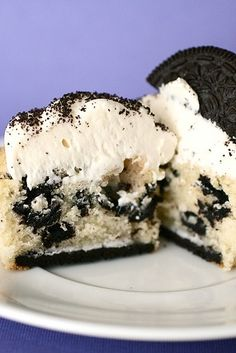 "Oreo cupcakes made the easy way: use a boxed cake mix (white cake), and store bought frosting. Line each cupcake liner with an ""opened"" Oreo. Add crushed Oreos to the batter and as a topping on the icing."