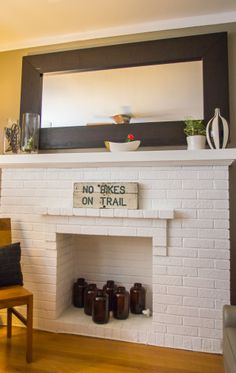 Loving the idea of a fresh painted unused fireplace. If you can't use it, you should at least decorate it Stephen & Antwann's Cool, Clever Home