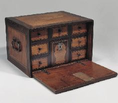 AN INDO-PORTUGUESE WOOD CABINET, INDIA, 17TH CENTURY  Of rectangular form, the front opening down to reveal six drawers each with knobs, the front, back and sides with inlaid panel, brass handles to sides - 16 x 11 x 13in (40.5 x 28 x 33cm)
