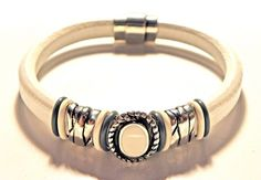 This unique original bracelet is made with authentic white Regaliz leather and centered in the middle is a gorgeous antique silver oval white resin slider bead On each side there Chunky Jewelry, Leather Jewelry, Beaded Jewelry, Custom Jewelry, Handmade Jewelry, Diy Jewelry, Jewelry Making, Jewellery, Leather Braces
