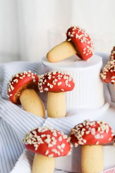 Strawberry almond mushroom cookies - chocolate cookies with a mushroom cap that is filled with almonds and jam. The red color will bring life to your cookie plate and holiday table. These hold well for at least a week! | mitzyathome.com