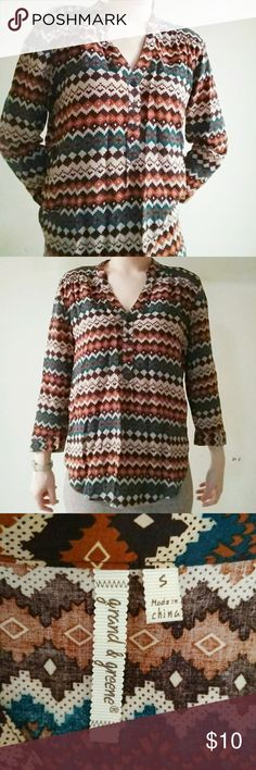 Vintage blouse Multicolor patterned blouse. 100% rayon. Found it in a thrift store but its quality and condition is excellent!! Vintage Tops Blouses