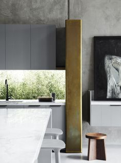 Fiona Lynch is a multidisciplinary design office in Australia who continually puts out interesting residential spaces with interesting materials and an over very modern and sleek look. This place is rich with wood, brass, marble and concrete.