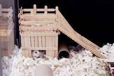 I present to you, my latest foray into hamster architecture: Fort Hamham! This was made using pretty much exactly 150 popsicle sticks (sad. Diy Hamster House, Hamster Diy Cage, Hamster Care, Hamster Stuff, Gerbil Toys, Gerbil Cages, Guinea Pig Toys, Diy Mouse Toys, Hamster Habitat