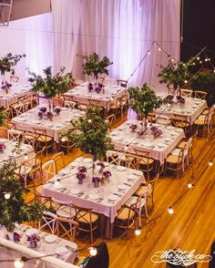 Square tables create the base of elegant formal tablescapes for a wedding reception dinner.