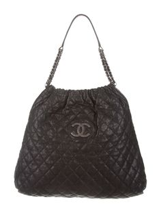 Black quilted caviar leather Chanel CC Large Tote with silver-tone hardware, logo embellishment at front, black satin interior lining, dual pockets at interior walls; one with zip closure and magnetic snap closure at top.